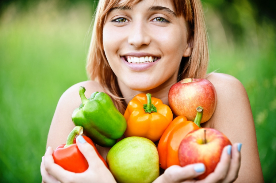 Girl with vegetables and fruits