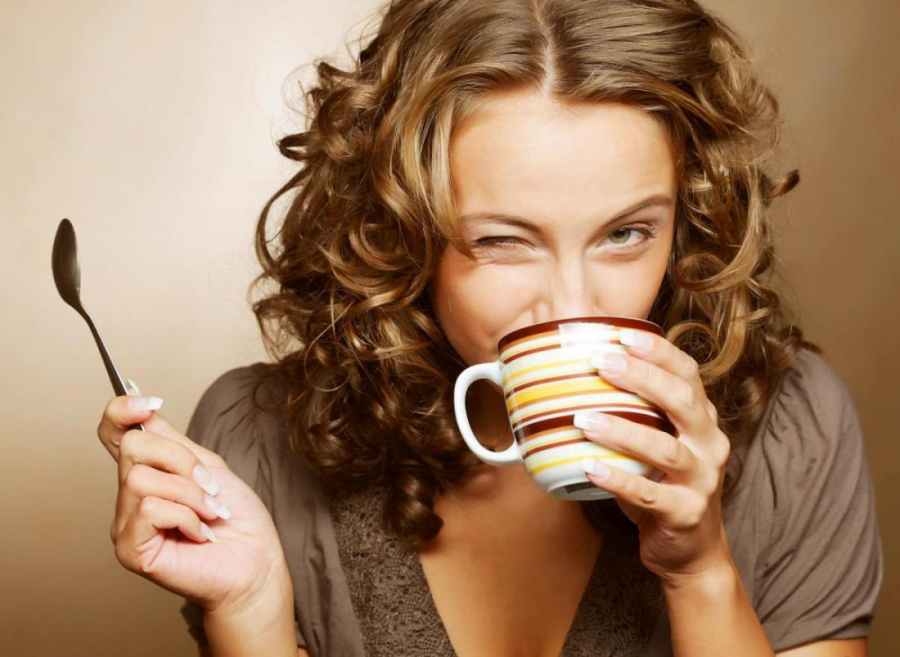 Girl with a cup and spoon