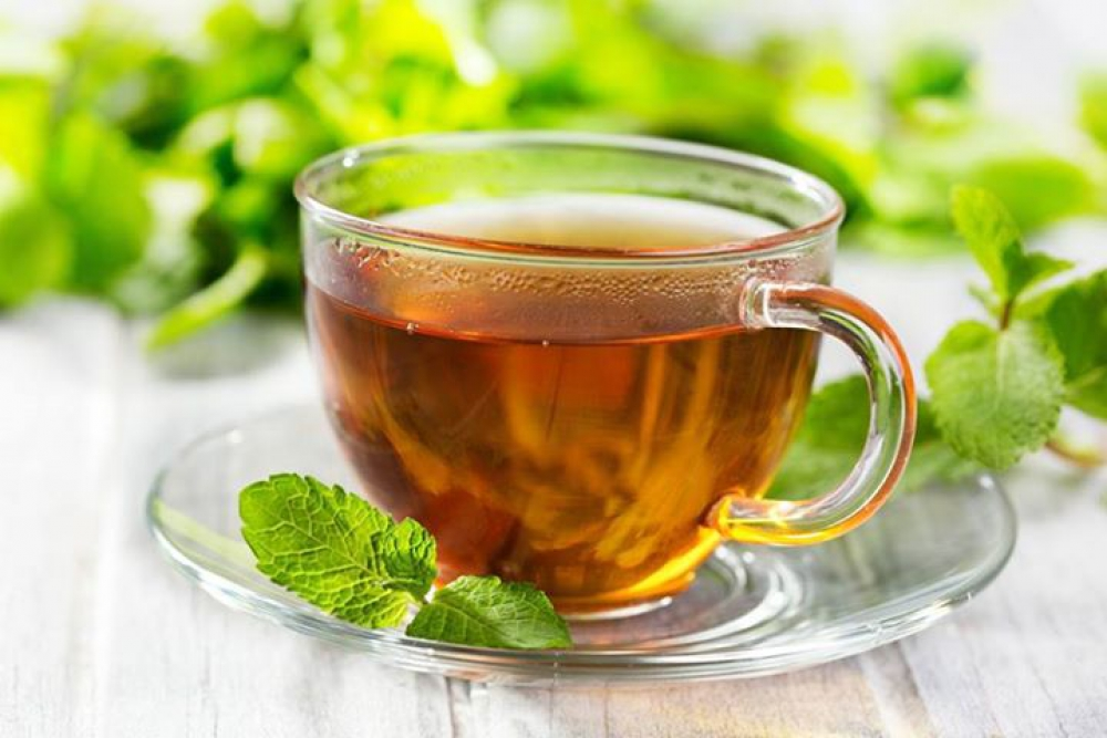 Cup and mint leaves