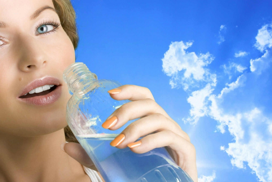 Girl with a bottle of water