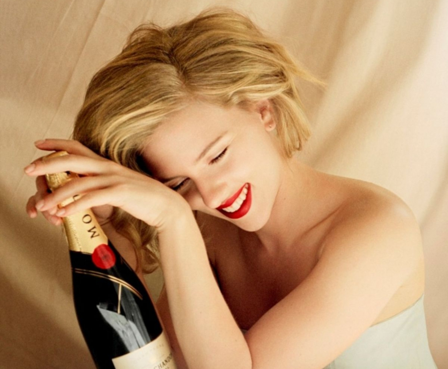 Girl with a bottle of champagne