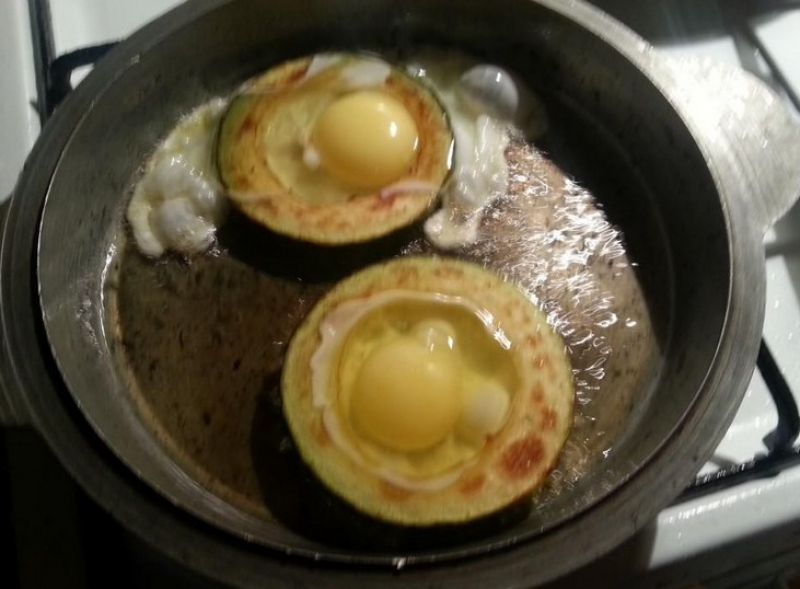 Eggs with zucchini in a pan