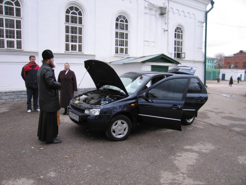 Priest and car