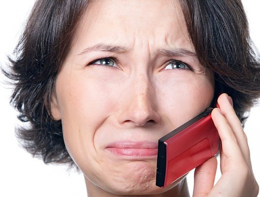 Upset woman and phone