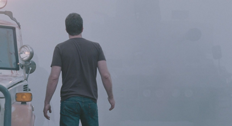 Man looking at the fog