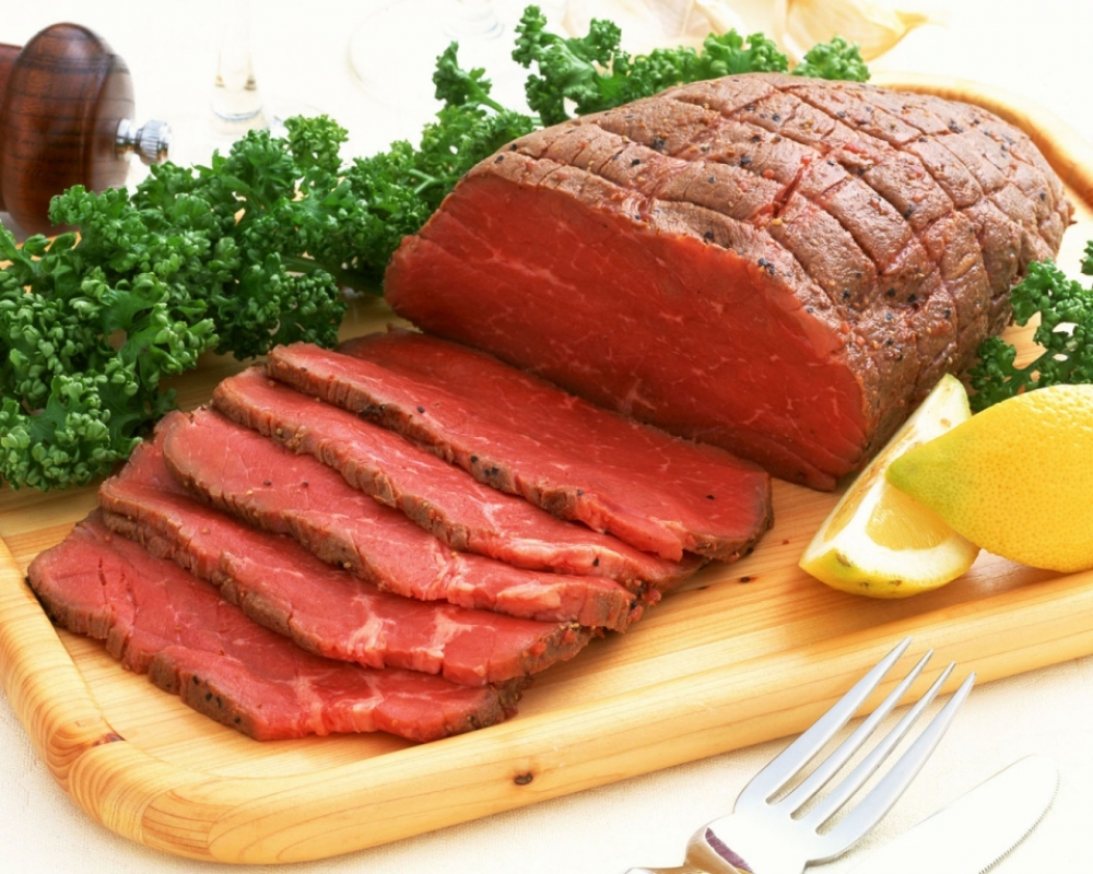 Meat with lemon and greens