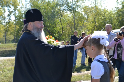 Priest blesses the girl