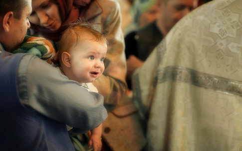 What is needed for the baptism of a boy