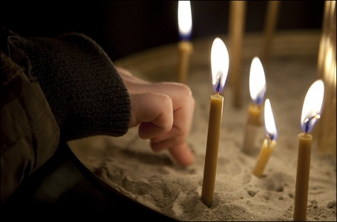Children's hand on the candlestick