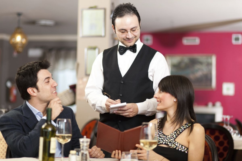 Waiter with visitors