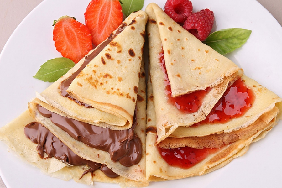 Pancakes with chocolate, strawberries and raspberries